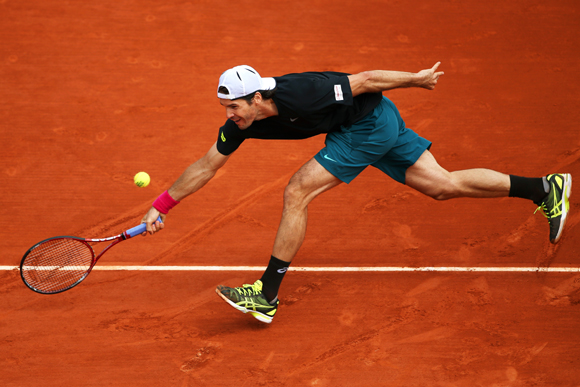 Tommy Haas of Germany plays a forehand during his match against Mikhail Youzhny of Russia