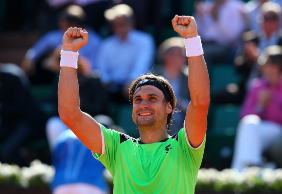 David Ferrer of Spain celebrates match point in his quarter final against compatriot Tommy Robredo