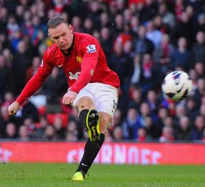 Wenger admits interest in signing Rooney, Fabregas