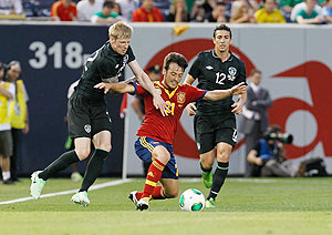 Spain's David Silva battles for the ball with Ireland's Andy Keogh and Stephen Kelly during an international friendly at Yankee Stadium on Tuesday