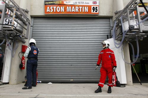 A race steward stands in front of the pit lane of Aston Martin number 95 during the Le Mans 24-hour sportscar race in Le Mans