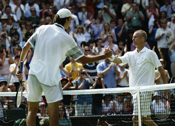 Ivo Karlovic of Croatia shakes hands at the net after beating defending champion Lleyton Hewitt of Australia in 2003