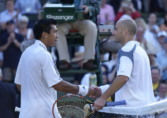 Paradorn Srichaphan of Thailand is congratulated by Andre Agassi of the USA