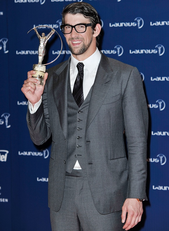 Michael Phelps poses with his award