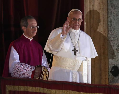 Newly elected Pope Francis I appears on the central balcony of St Peter's Basilica