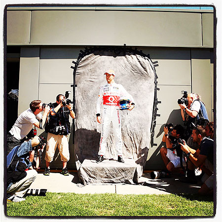 Jenson Button of McLaren poses for photographers at the drivers official portrait session during previews to the Australian Formula One Grand Prix at the Albert Park Circuit on Thursday