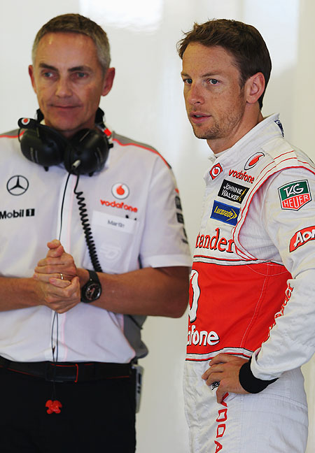 McLaren's Jenson Button talks with his Team Principal Martin Whitmarsh as he prepares for  practice for the Australian Formula One Grand Prix at the Albert Park Circuit on Friday