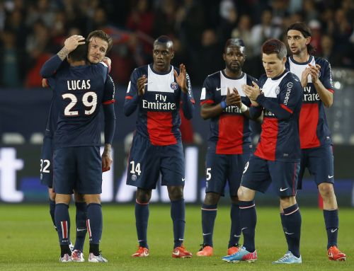 Paris Saint-Germain's David Beckham (facing camera, on 2nd L) hugs team-mates and breaks down in tears after he is substituted in the 81st minute