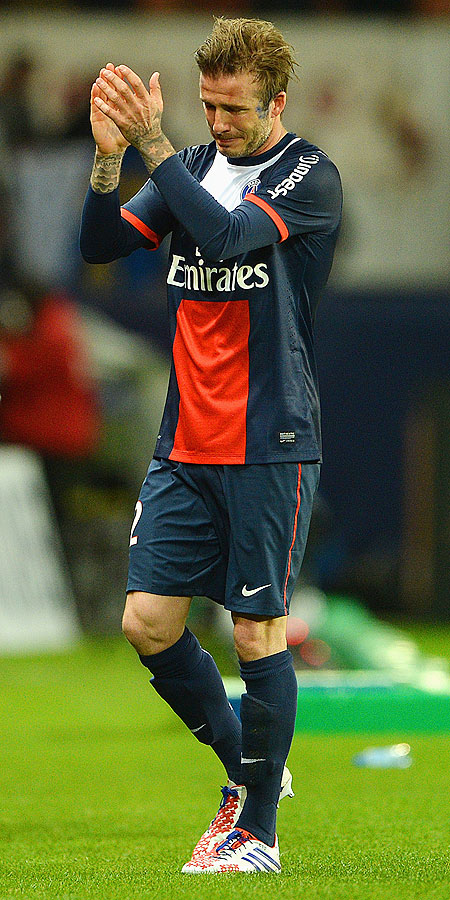 David Beckham of PSG reacts as he is substituted during the Ligue 1 match