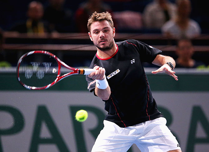 Stanislas Wawrinka of Switzerland in action in his match against Nicolas Almagro of Spain the BNP Paribas Masters at Palais Omnisports de Bercy in Paris on Thursday
