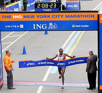 Geoffrey Mutai of Kenya crosses the finish line in Central Park to win the 2013 ING New York City Marathon on November 3