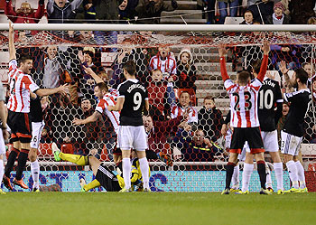 Sunderland's Phil Bardsley (2nd from left) celebrates after scoring against Southampton during their English League Cup fourth round match at the Stadium of Light in Sunderland, on Wednesday