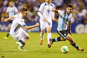 Sergio Aguero of Argentina runs past Ermin Bicakcic (left) of Bosnia-Herzegovina during the international friendly match between Bosnia-Herzegovina and Argentina at Busch Stadium in St. Louis, Missouri on Monday