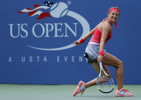 Victoria Azarenka of Belarus checks a shot to Alize Cornet of France at the U.S. Open