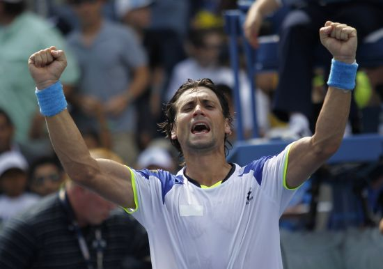 David Ferrer of Spain celebrates after defeating Mikhail Kukushkin of Kazakhstan