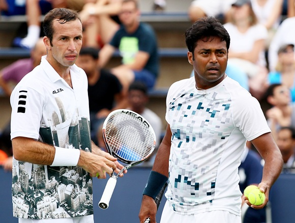 Radek Stepanek of Czech Republic looks on next to his partner Leander Paes of India
