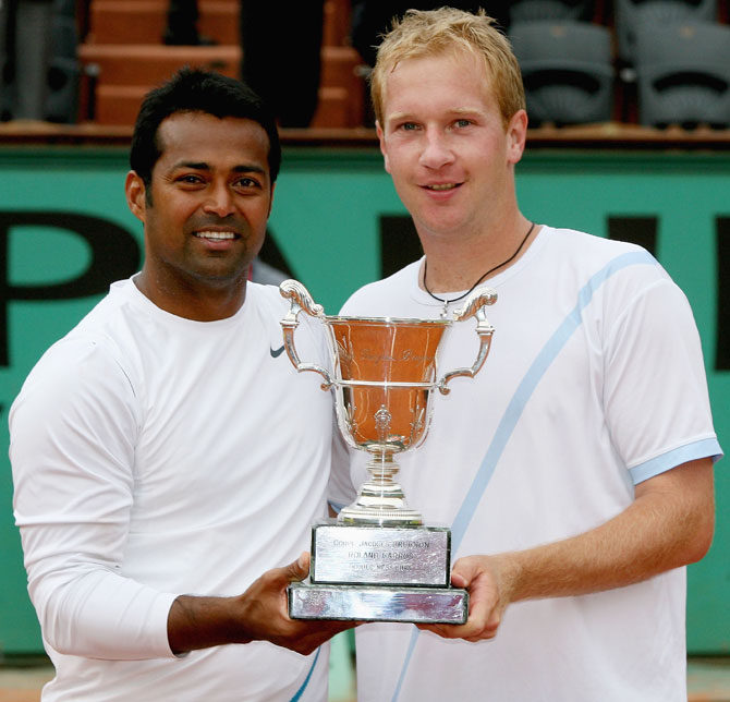 Leander Paes (left) and Lukas Dlouhy of the Czech Republic pose with the French Open trophy