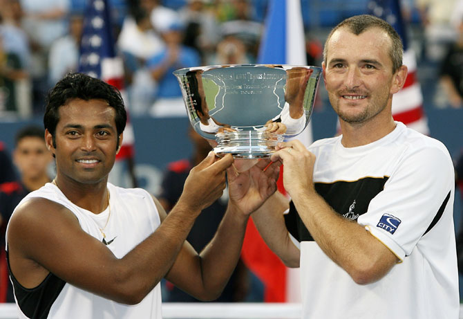 Martin Damm of the Czech Republic and Leander Paes (left) pose with their US Open trophy