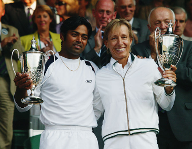Leander Paes and Martina Navratilova with the Wimbledon trophy