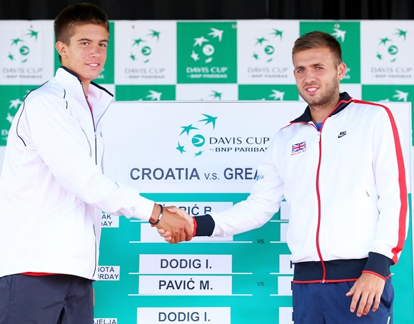 Daniel Evans of Great Britain shakes hands with second day opponent Borna Coric of Croatia
