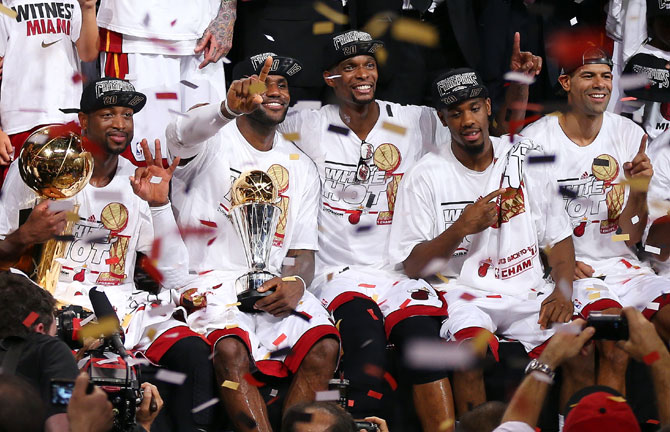 Dwyane Wade #3, LeBron James #6, Chris Bosh #1, Norris Cole #30 and Shane Battier #31 of the Miami Heat celebrate after defeating the San Antonio Spurs 95-88 to win Game Seven of the 2013 NBA Finals