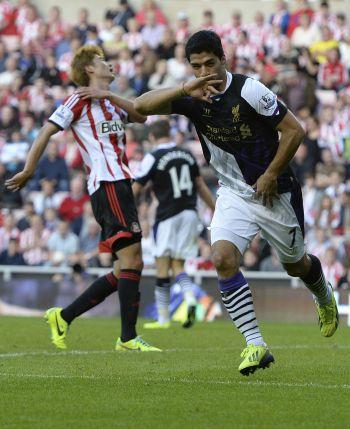 Suarez nets two on League return as Liverpool win
