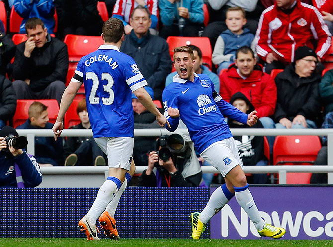 Gerard Deulofeu (right) of Everton celebrates his team's goal with teammate Seamus Coleman during their English Premier League match against Sunderland at the Stadium of Light in Sunderlandon Saturday