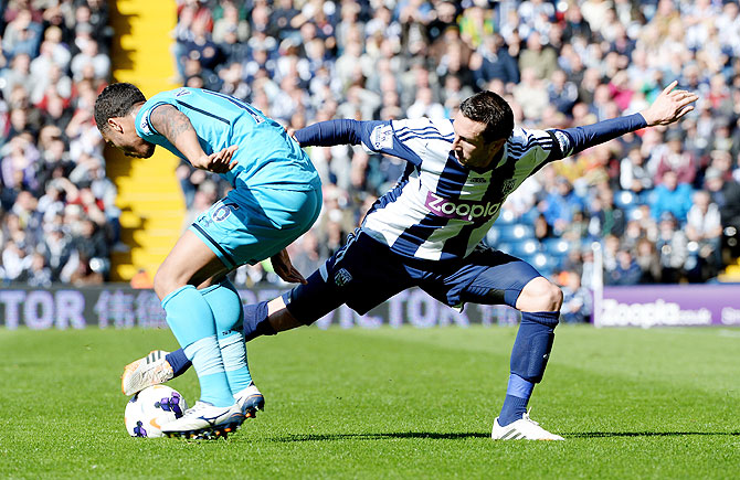 Graham Dorrans of West Bromwich Albion is challenged by Kyle Naughton of Tottenham at The Hawthorns in West Bromwich on Saturday