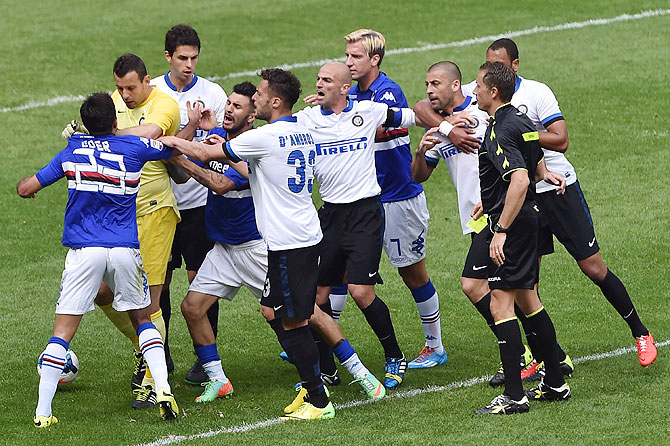 Inter Milan and Sampdoria players get involved in a scuffle during their Serie A match at Stadio Luigi Ferraris in Genoa, Italy on Sunday