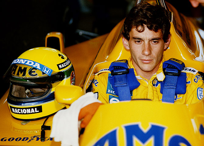 Ayrton Senna of Brazil sits aboard the #12 Camel Team Lotus Honda Lotus 99T Honda RA166E V6 turbo during practice for the Brazilian Grand Prix on 11th April 1987 at the Autodromo Internacional Nelson Piquet Jacarepagua circuit near Rio de Janeiro, Brazil