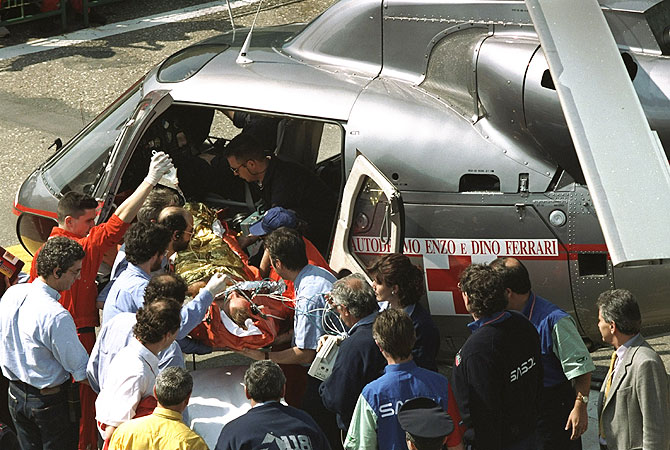 Rubens Barrichello of Brazil is airlifted to the hospital after crashing at 160 mph in his Jordan Hart during the first official practice for the San Marino Grand Prix at the Imola circuit in San Marino on May 1, 1994