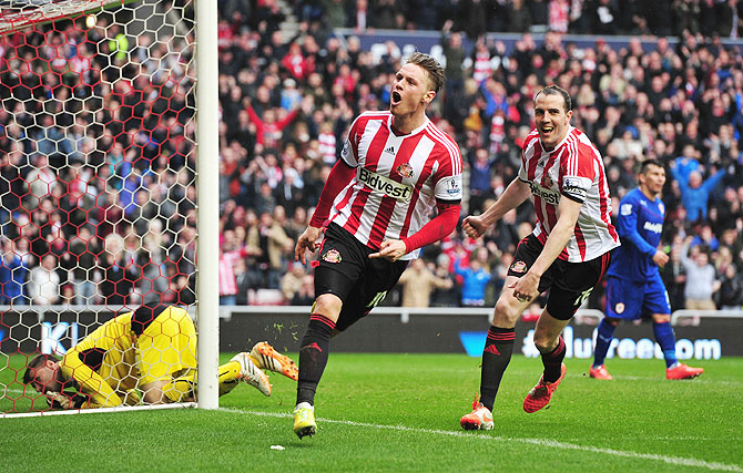 Connor Wickham of Sunderland celebrates scoring his second goal with teammate John O'Shea during the English Premier League match against Cardiff City at the Stadium of Light on Sunday