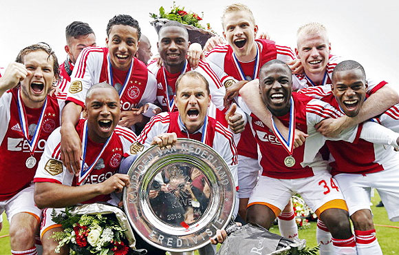 Ajax's Frank de Boer and his players celebrate at Polman stadium in Almelo, The Netherlands on Sunday