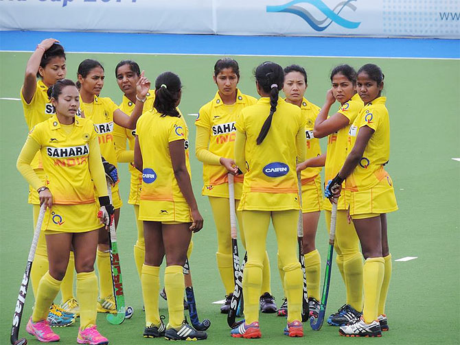A dejected Indian women's hockey team after the match