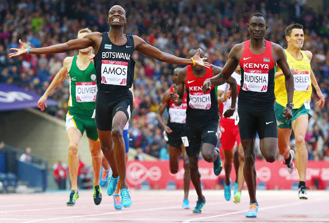 Nijel Amos of Botswana crosses the line to win gold ahead of David Rudisha of Kenya in the Men's 800 metres final at Hampden Park on Day 8 of the Glasgow 2014 Commonwealth Games on Thursday