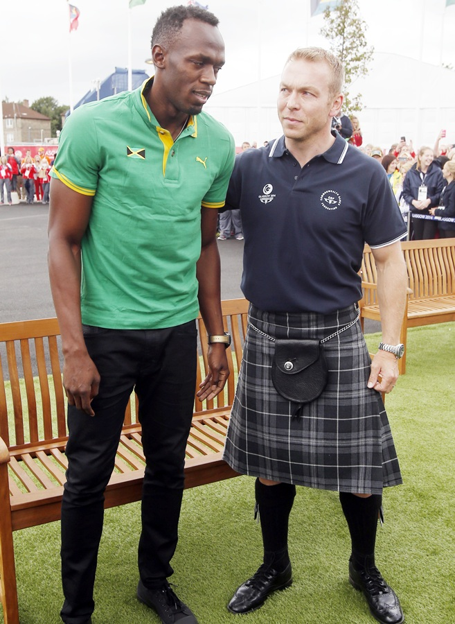 Sir Chris Hoy meets Usain Bolt during a visit to the Commonwealth Games Village