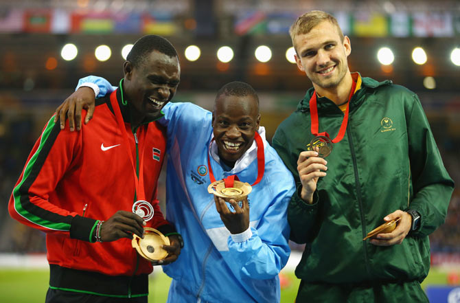 Silver medallist David Rudisha of Kenya, gold medallist Nijel Amos of Botswana and bronze medallist Andre Olivier of South Africa pose on the podium during the medal ceremony for the Men's 800 metres on Thursday