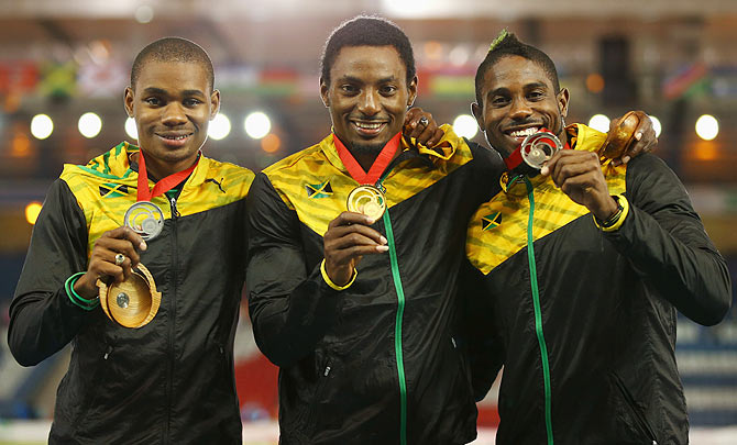 Silver medallist Warren Weir of Jamaica, gold medallist Rasheed Dwyer of Jamaica and bronze medallist Jason Livermore of Jamaica pose on the podium during the medal ceremony for the Men's 200 metres at Hampden Park on Thursday