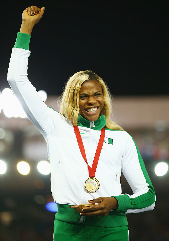 Gold medallist Blessing Okagbare of Nigeria on the podium during the medal ceremony for the Women's 200 metres at Hampden Park on Thursday