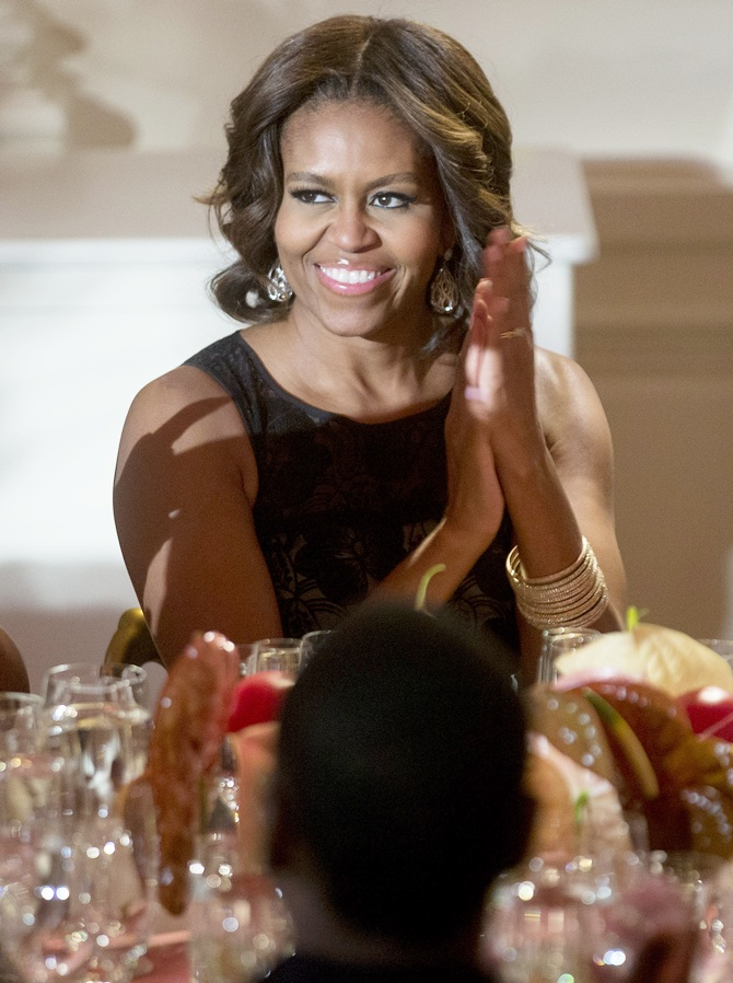 US First Lady Michelle Obama claps while listening to US President Barack Obama, not   pictured, speak at an event titled 'A Celebration of Special Olympics and A Unified Generation' to mark the anniversary of the Special Olympics