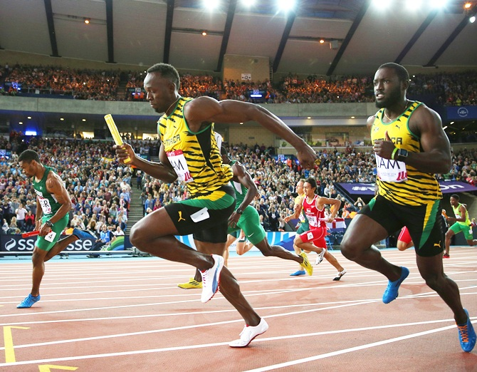 Usain Bolt of Jamaica competes in the Men's 4x100 metres relay heats at Hampden Park during day nine of the Glasgow 2014 Commonwealth Games