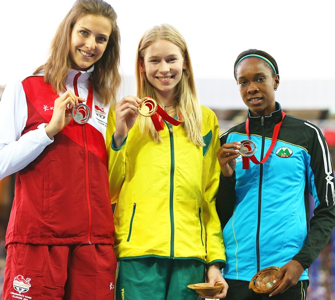 From left, Silver medallist Isobel Pooley of England, gold medallist Eleanor Patterson of Australia and bronze medallist Levern Spencer of Saint Lucia pose on the podium during the medal ceremony for the Women's High Jump at Hampden Park
