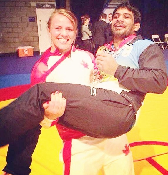 CWG PHOTOS: Female athlete lifts Sushil Kumar!