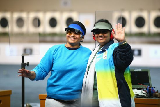Gold medalist Rahi Sarnobat (left) and silver medalist Anisa Sayyed celebrate at the end of the women's 25m Air Pistol shooting