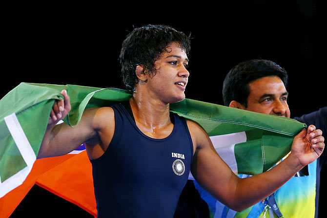Babita Kumari of India celebrates winning the gold medal in the women's freestyle 55kg wrestling