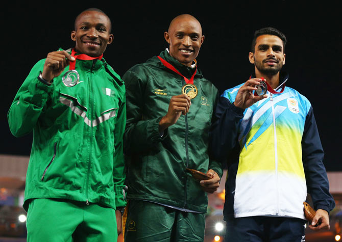 (Left-Right) Silver medalist Tosin Oke of Nigeria, gold medalist Khotso Mokoena of South Africa and bronze medalist Arpinder Arpinder Singh of India pose on the podium during the medal ceremony for the Men�s Triple Jump at Hampden Park on Saturday