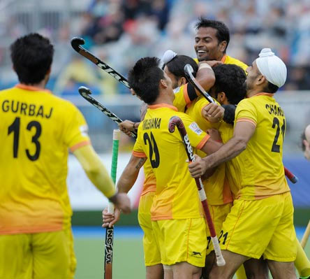 India's hockey players celebrate winning their match against New Zealand