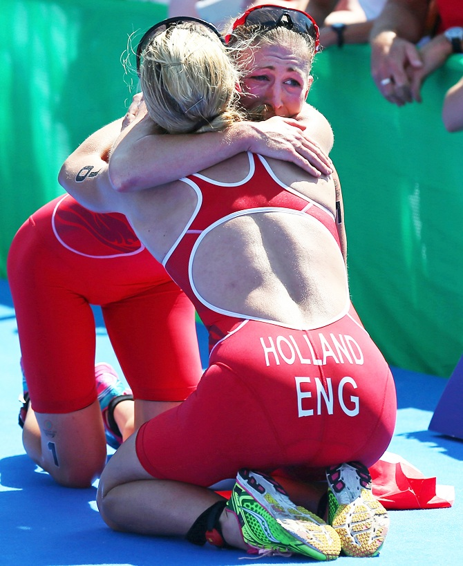 Jodie Stimpson of England celebrates with Vicky Holland of England after they win Gold and Bronze in the Women's Triathlon at Strathclyde Country Park during day one of the Glasgow 2014 Commonwealth Games