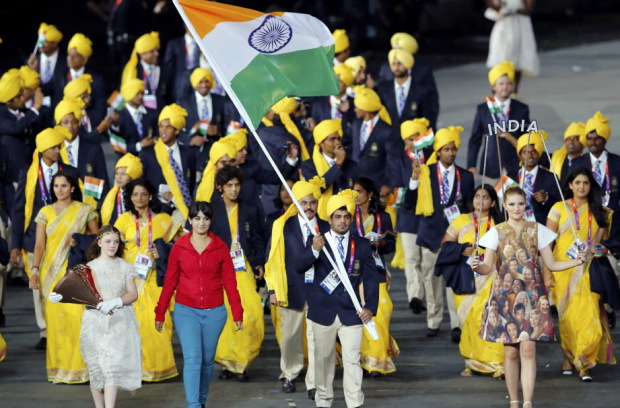 An unidentified woman walks with the Indian contingent at the London Olympics