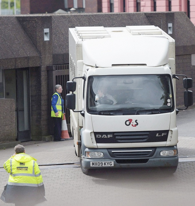 A police van carrying IOA officials arrives the Sheriff Court of Glasgow and Strathkel on Monday